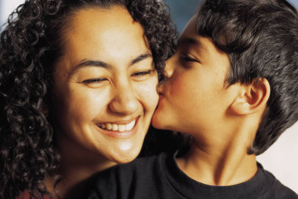 Domestic Violence Solutions: Son kissing happy mother