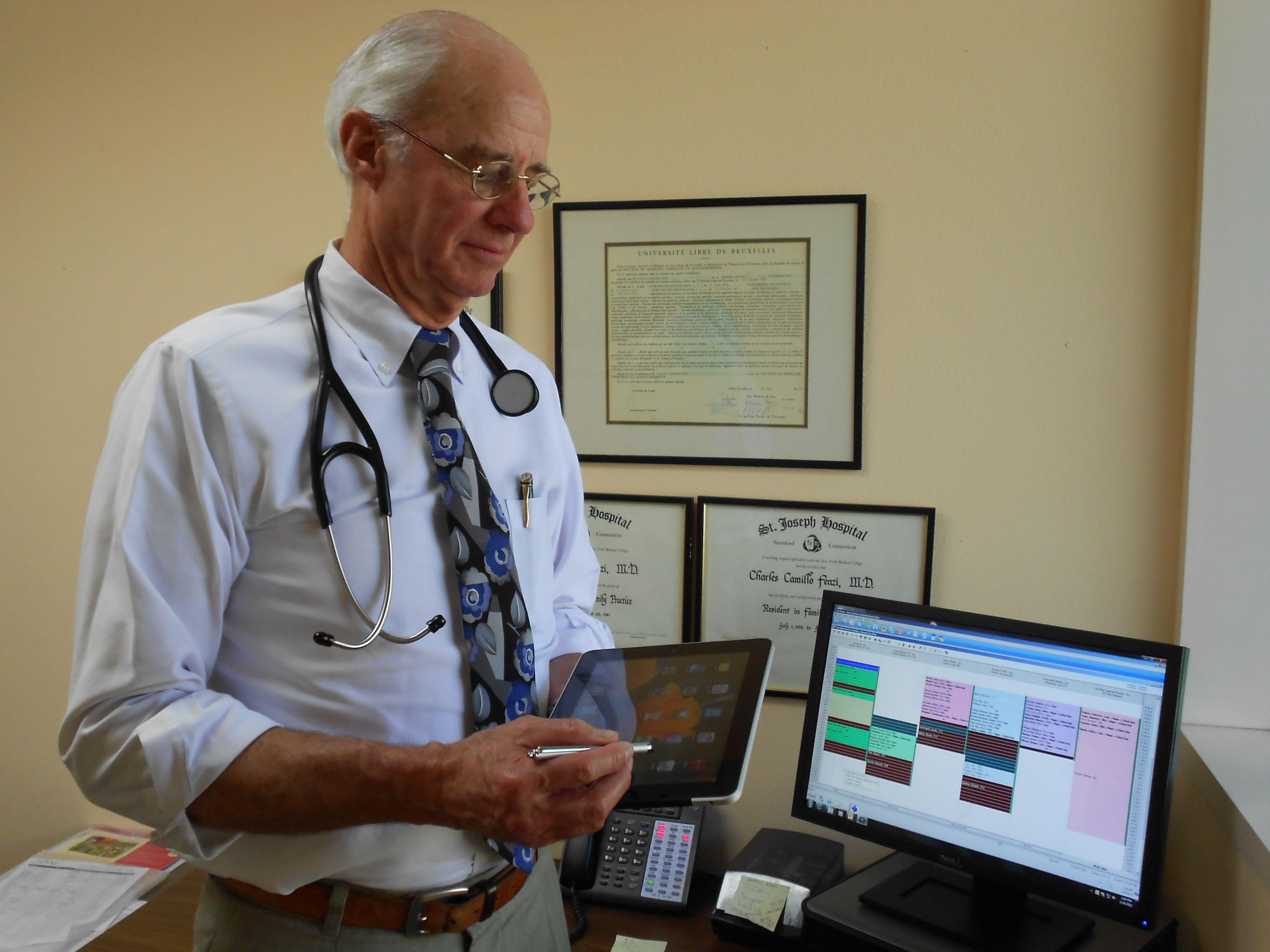Santa Barbara Neighborhood Clinics: doctor with electronic files on computer