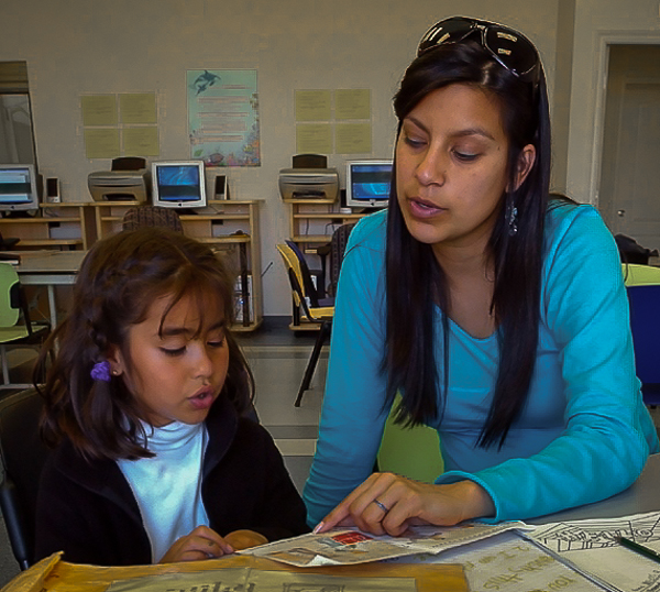 People's Self-Help Housing: tutor working with young student