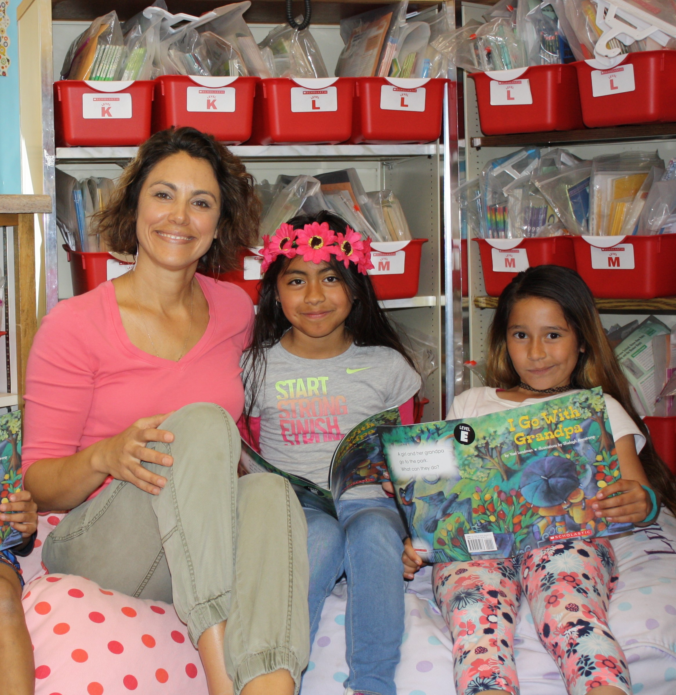 Dyslexia Intervention Program - Teacher reading with girls and flowers