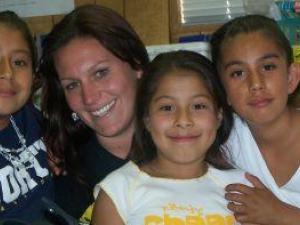 People's Self-Help Housing, Teacher with Girls