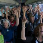 Women's Fund members and guests tour grantee sites on four SB Airbuses