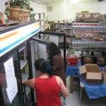 Catholic Charities: food pantry with customers