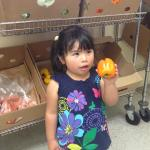 Catholic Charities: food pantry with little girl customer