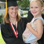 SBCC Single Parent Achievement Program: graduate with her daughter in her arms
